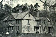 Louisa May Alcott's Orchard House, Concord, Massachusetts  -  An 1874 photograph of the house with Mr. & Mrs. Alcott in the front yard...