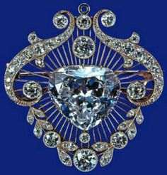The Cullinan V brooch Probably GarrardsThe unusual heart-shaped stone of 18.8 carats, given by the Government of South Africa to Queen Mary in 1910, is one of the nine numbered Cullinan diamonds. In its diamond and platinum setting, it was designed both as a brooch and as the detachable centre of the emerald and diamond stomacher made for the Delhi Durbar in 1911For the 1937 coronation,