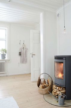 "42 Lovely Scandinavian Fireplace To Rock This Year. A stone fireplace design your pioneer ancestors would envy is the ""Multifunctional Fireplace. Scandinavian Fireplace, Scandinavian Cottage, Scandinavian Style, Scandi Style, Style At Home, Home And Living, Home And Family, Cozy Living, Attic Renovation"