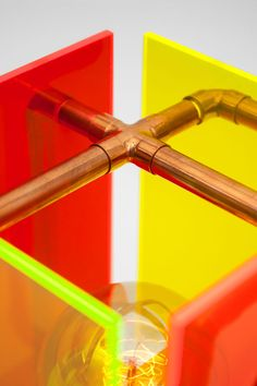 Detail of Pompido - conceptual design table lamp made of colorful, fluorescent plexiglass and copper pipes - colorful combination of industrial and 80's style design