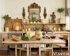 image from Veranda magz. love the whole thing... light pine kitchen cupboards, open shelving, antique bread boards...