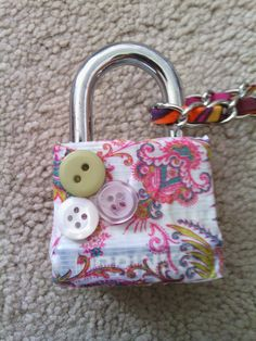 Decorate your locker lock!!! Just put your choice of colored duct tape around your key lock. Then use anything you might have around the house to decorate- i used buttons! Its soooo cute, easy and you will have the cutest lock in the school!