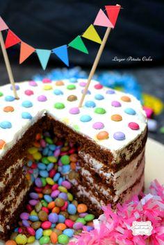   Layer Piñata Cake   Chocolat et Coco  © Les Gourmands {disent} d'Armelle A l'occasion des 30 ans du Téléthon , France 2 a demandé à certains blogueurs de réaliser un gâteau d'anniversaire. J'ai décidé d'en faire un représentant mon univers gourmand...