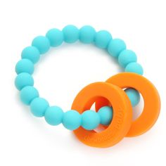 Baby Teether in Turquoise - Looking for an amazingly adorable, yet functional teething accessory? This bright colored silicone teether will soothe baby's gums and is 100% safe.