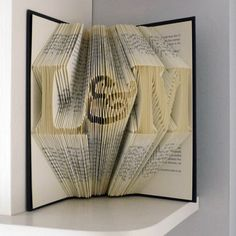 Book Art - First Paper Anniversary - Monogrammed - Girlfriend - Two initials with & in between - Folded Book via Etsy
