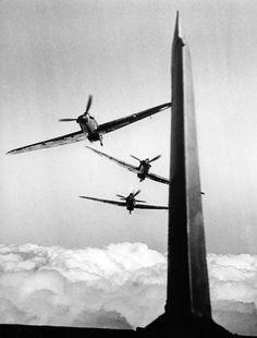 Hawker Hurricane Mk1s in line astern.