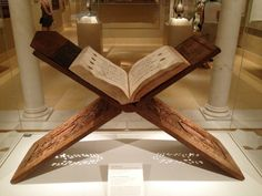 Quran Stand.   400 years earlier than Roubo, a beautiful folding book stand from a single large board with an integral wooden hinge. Metropolitan Museum of Art. The stand was made by Hasan [ibn] Zain ibn Sulaiman al-Isfahani.