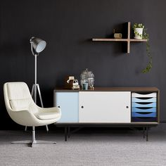 Kaufmann is an outstanding sideboard, perhaps the finest and most distinctive example of this particular style. The considered, tonal coloration and framework detailing are of notable excellence. A classic Mid-Century Modern piece.