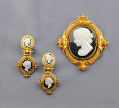 Antique 18kt Gold and Hardstone Cameo Suite, the elaborate brooch set with a cameo depicting a maiden with flowing curls, framed by multiple strands of delicate ropetwists, scrolling terminals with applied bead accents, earpendants en suite, 2 1/2 x 2 3/8, lg. 2 in.,