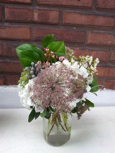 Mason jar arrangement of hydrangea and chocolate Queen Anne's Lace.