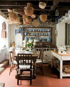 .Country kitchen, love the hanging baskets