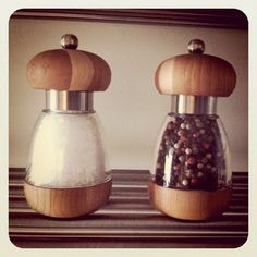 Crate and Barrel salt and peppers grinders