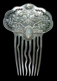 British arts and crafts piece by Arthur and Georgie Gaskin, c. 1910. The raised silver-foliage design is bookmarked by pearls....