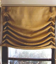 "think my roman shade will maybe look more like this.. with ribbon through eyelets in the fabric &  ""cord lock stoppers on the bottom (hello i did not know WHAT those where called -had to google all sorts of wierd stuff) and lets give it some better color than that camel poop shade"
