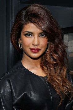 Dark wood hair color with light brown highlights