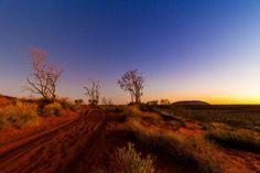 The back road to #Uluru @ sunset @VanessaOHanlon  @CanonAustralia @AusOutbackNT @abcopen  @NatGeoPhotos  www.parkmyvan.com.au #ParkMyVan #Australia #Travel #RoadTrip #Backpacking #VanHire #CaravanHire