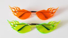 An extra twist on the classic meteor glasses. Brighter colors with a fluorescent edge. Available in neon orange and neon green. Neon Green Outfits, Neon Green Nails, Neon Aesthetic, Aesthetic Fashion, Aesthetic Clothes, Neon Accessories, Fashion Accessories, Kourtney Kardashian, Billie Eilish
