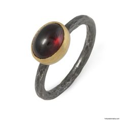Lika Behar Candy-Sterling Silver oxidized with 24 karat gold and oval garnet. Available at 14 Karat Omaha