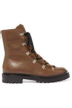 Rubber sole measures approximately 30mm/ 1 inch Brown leather Lace-up front, zip fastening along back  Made in Italy