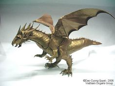 Ancient Dragon This gold origami dragon was made using 21 sheets of paper by Dao Cuong Quyet. I think the crispness and the details are amazing, especially the scales. Part of the Vietnam Origami Group. Ancient Dragon, Origami Dragon, Dragon, Origami Art, Paper Animals
