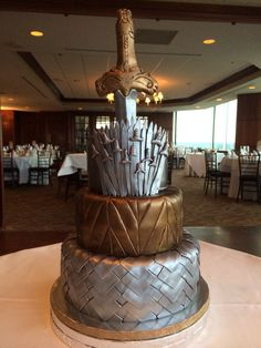 Game of Thrones inspired 3-tier sword cake in silver and bronze www.cuteandsweetboutique.com https://m.facebook.com/pages/Cute-and-sweet-boutique/234906629885747