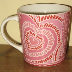 """This pretty-in-pink Starbucks Coffee Mug is one of a pair of definitely very """"girly"""" coffee mugs given the color and the hearts! It was created by the Starbucks company in 2005, presumably for Valentine's Day...I love it. How about you? #starbucks #valentinesday"""