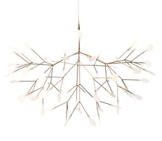 Heracleum LED suspension was inspired by the Heracleum plant. The white leaves/lenses ramify from one branch creating a very technical, natural structure. The Heracleum leaves are not frozen in one position. They can be freely re-positioned by rotating them around their stem. Finish available in copper (shown) or nickel.  63, 3000K warm white LED lamps totaling 14 watts.  Dimmable with a DV-603PG di...