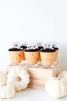 "graveyard pumpkin desserts are made of yummy pumpkin mousse, oreo ""dirt"" and candy graves."