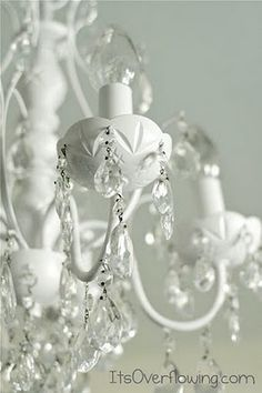 spray painting an old chandelier