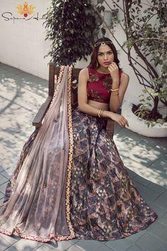 Maroon raw silk blouse, tussar silk printed skirt, taupe soft net dupatta