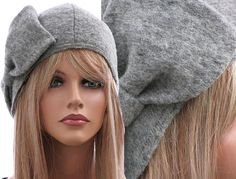 Artsy handmade womens winter hat / cap in grey / soft boiled wool / M unstretched - up to L stretched. $52.00, via Etsy.