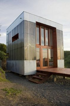 This small cabin in a rural area of central Chile uses little energy and has a low carbon footprint. AATA Arquitectos designed the cabin, opting for a two level floor plan to minimize the site impact. The cabin takes the shape of a cube that is 5.4 m (17'9″) on each side.