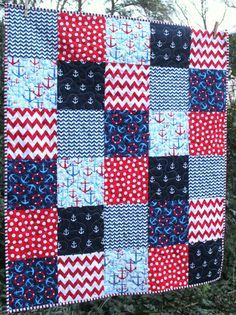 This quilt is completed and ready to ship to you! It features a fun, nautical theme and a patriotic, boy-friendly color palette of navy blue, red,