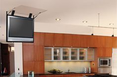 """The folding ceiling lift requires minimal depth in the ceiling (about 6-8"""" for a 42"""" Plasma). The TV literally folds down from the ceiling w..."""