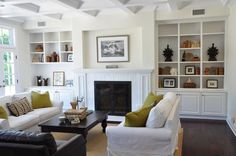 love the built-in bookcases. and ceiling. and crisp white with pops of color. and dark hardwood floors. love.