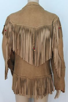 """This gorgeous women's jacket has a few issues, but is still super fabulous. The lining is pretty much completely shot, and there are a few minor discoloration spots, as is quite common with vintage leather. One of the patch pockets has a very diy repair on it, and a few strands of fringe are missing but this really is a cool jacket, and I have priced it accordingly. It has a 36"""" bust measurement and is 28"""" in length."""