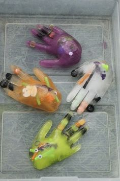 "Melting ice in frozen, water-&-halloween-goodie-filled surgical gloves with salt - from happy hooligans ("",)"