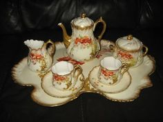 Here we have a beautiful M. Redon Limoges tea set! Tray, tea pot, sugar bowl, milk jug and 2 cups and saucers! All hand painted in fantastic style of flowers. Gold gilt edging in good condition! This