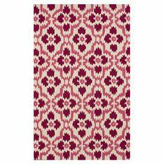 Add a touch of exotic allure to your den or bedroom with this hand-tufted rug, showcasing a chic ikat-inspired motif.   Product: RugConstruction Material: 100% PolyesterColor: PinkFeatures: Hand-tuftedNote: Please be aware that actual colors may vary from those shown on your screen. Accent rugs may also not show the entire pattern that the corresponding area rugs have.Cleaning and Care: Spot treat with a mild detergent and water. Professional cleaning is recommended if necessary.