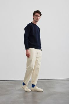 Studio Nicholson Exudes Sophisticated Minimalism: Clean lines inform the relaxed silhouettes. Minimal Outfit, Minimal Fashion, Studio Nicholson, How To Pose, Men Street, Look Cool, Mens Fashion, Guy Fashion, Sporty Fashion