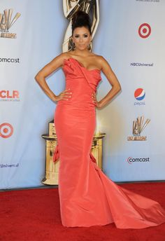 Pin for Later: Something Fishy! The Greatest Mermaid Dresses of All Time  Eva Longoria looked amazing in this sculpted coral fishtail gown at the 2011 ALMA awards.