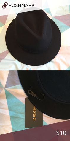 NWT Felt Fedora Black felt fedora with tag. Purchased the wrong size! It's a M/L. NWT. Forever 21 Accessories Hats
