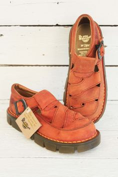 orange vintage leather dr. Martens. Not only available for kids, we have dem in bigger sizes... www.sugarsugar.nl