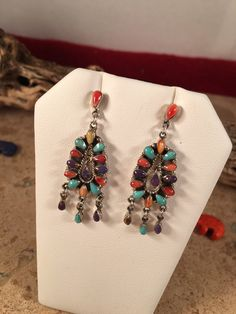 A personal favorite from my Etsy shop https://www.etsy.com/listing/267587197/sterling-silver-multi-stone-zuni-dangle