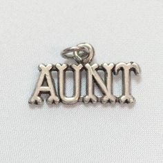 "For that special aunt! Measures approximately x This charm is sterling and comes standard with an ""o"" ring. You can have the charm soldered at a jeweler's. Or, order a split ring, and you can attach the charm to a bracelet yourself."