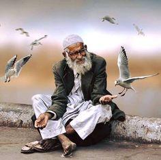 Man & Seagulls…….by Brigitta Moser Pain & smile Photograph PAIN & SMILE PHOTOGRAPH | IN.PINTEREST.COM WHATSAPP EDUCRATSWEB