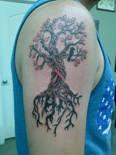 My tree of life tattoo with a cancer ribbon
