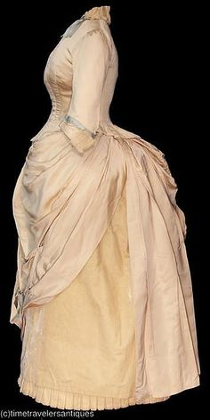 Simply stunning creamy-coloured bustled dress.