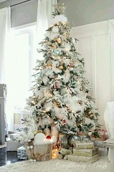 Christmas Tree decorated with snow feathers and pastel color balls
