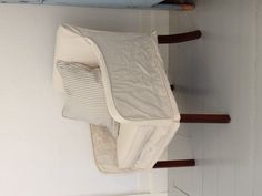$2.00 motel chair slip covered. Don't over look the obvious. Terry John Woods